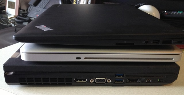 Stacked from thin to not: Lenovo X1 Carbon Touch, MacBook Pro, Lenovo W520