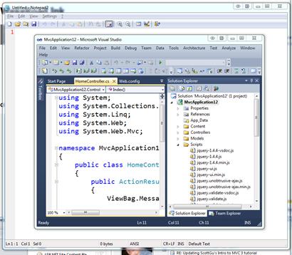 Notepad open behind Visual Studio