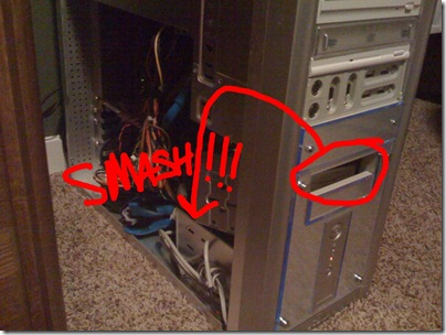 Photo of the open side of my Computer Case with the Floppy casing falling on my hard drive with arrows and the word SMASH in red.